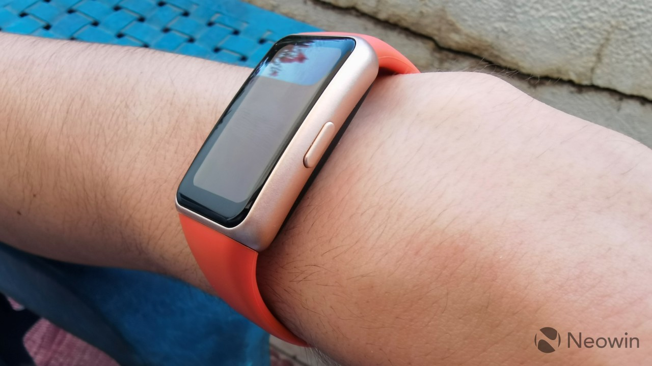 Huawei Band 6 wrapped around a wrist and seen from the right side