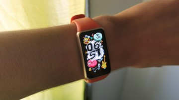 A Huawei Band 6 displaying the Graffiti watch face