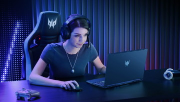 A woman using the Acer Predator Trion 300 gaming laptop with wireless accessories