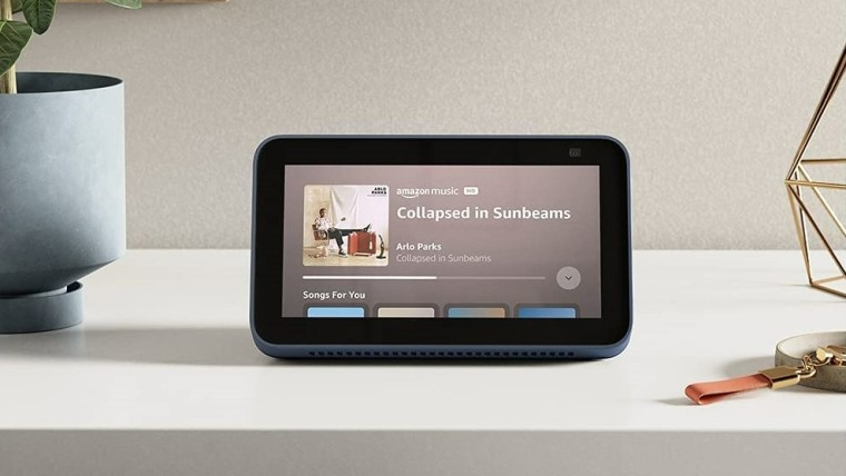 Front view of the new Echo Show 5 playing a song on Amazon Music
