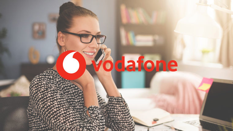 The Vodafone logo and a woman on the phone