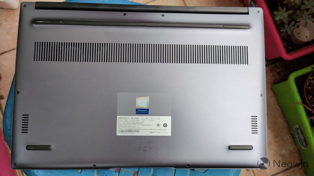 The underside of the Honor MagicBook 14 showing its speakers and air intake vents