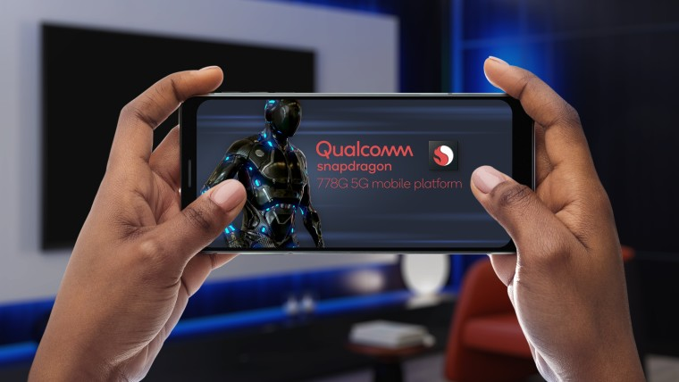 A smartphone displaying the Qualcomm Snapdragon 778G logo with a generic game character