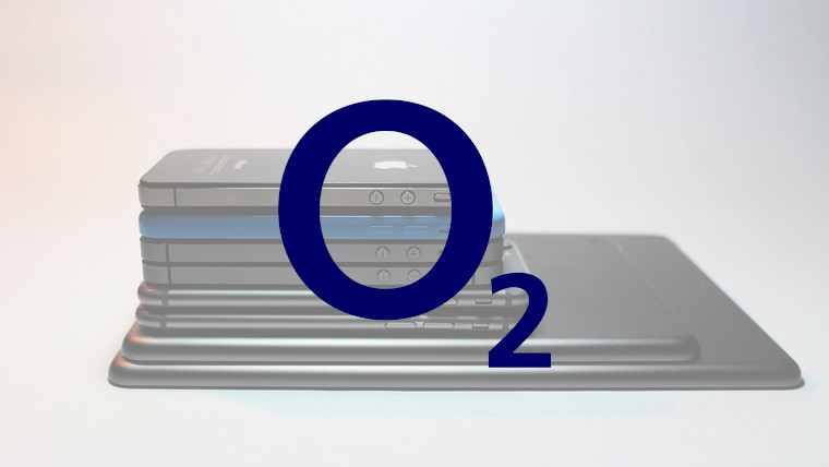 The O2 logo in front of old Apple devices