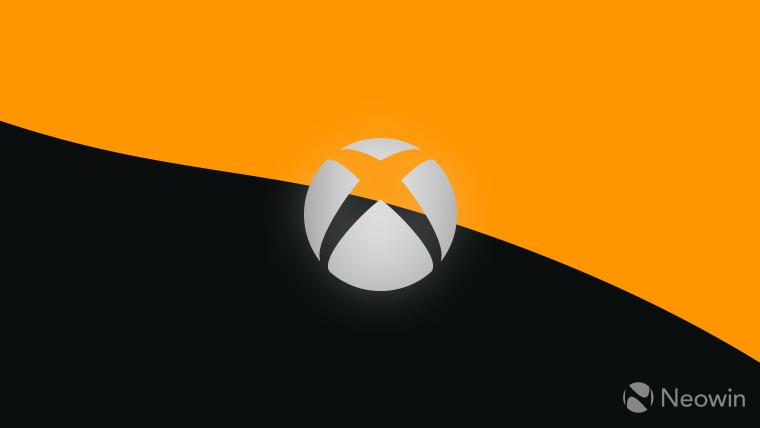Xbox logo grey on dark grey and orange background