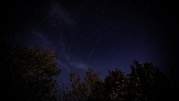 A satellite in the night sky