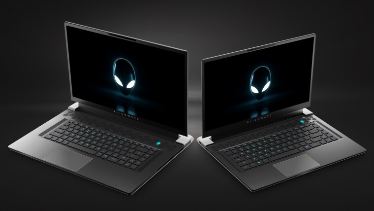 Alienware x17 and x15 laptops with the lids open seen from the front next to each other
