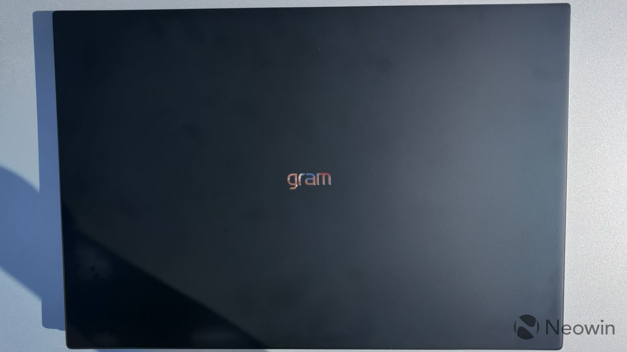 Overhead view of the LG gram 16 with the lid closed showing the gram logo