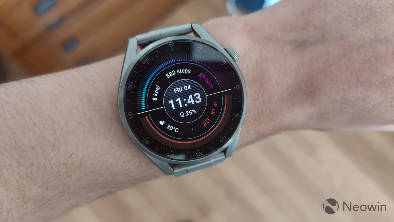 Huawei Watch 3 Pro displaying a colorful watchface with activity and weather info