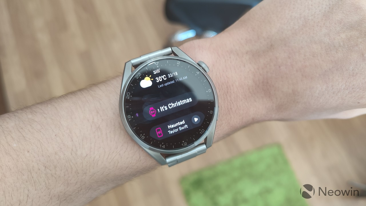 Huawei Watch 3 Pro weather widget with multi-device music controls underneath