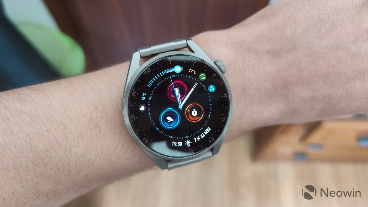 Huawei Watch 3 Pro worn on a wrist displaying an analog watch face