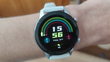 RedMagic Watch displaying a watch face showing activity stats and a digital clock