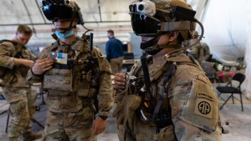 Two US Army soldiers wearing HoloLens headsets