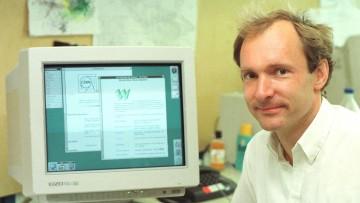 Tim Berners-Lee sitting in front of a desktop