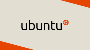 The Ubuntu logo on a grey and orange wallpaper