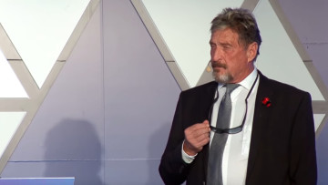 John McAfee delivering a speech
