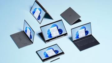 Multiple PCs running Windows 11 laid on the ground
