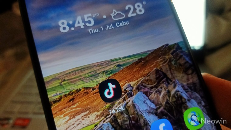 TikTok icon on a phone screen