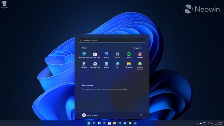 A Windows 11 Start screen with a search box at the top of the apps