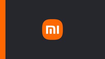 The Xiaomi logo on a gunmetal black and orange background