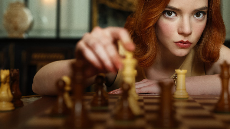 Beth Harmon from The Queen&039s Gambit moving a chess piece