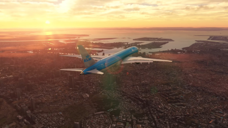 A Boeing 787 airliner flying over a city at sunset