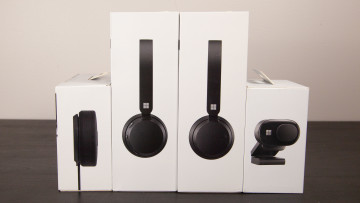 Boxes of the Microsoft Modern accessories including USB headset wireless headset webcam and speaker