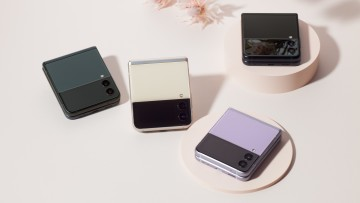 Samsung Galaxy Z Flip3 devices in violet cream blue and black laid on a table