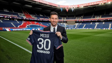 Messi holding his new No 30 PSG jersey