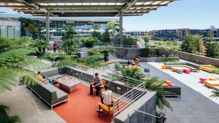 Facebook employees sitting on a couch inside its campus in Menlo Park