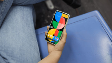 A persons hand holding a Google Pixel 5a 5G phone