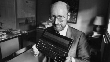 Clive Sinclair holding a home computer