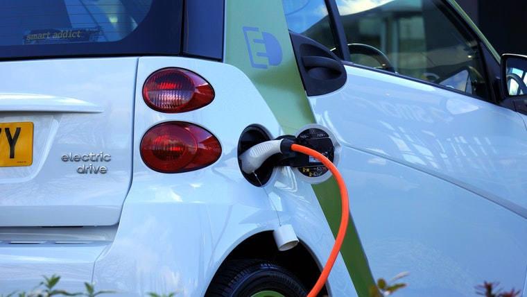 An electric car recharging