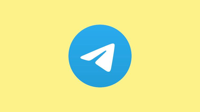 The Telegram logo on a pastel yellow background