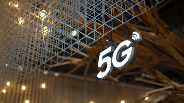 A 5G hanging from a sign